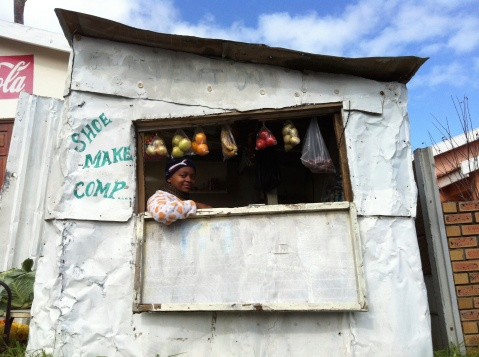 A woman running a small business in one of the shanty towns of Cape Town